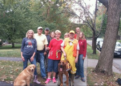 Ohio Pet Detective Jim Berns poses with a crew of volunteers and Bloodhound. This missing dog was found by the Search Dogs in the neighborhood of Wyoming in Cincinnati, Ohio.
