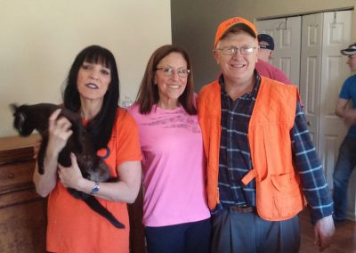 Ohio Pet Detective Jim Berns Helps Find Lost Pets Using Search Dogs and Other Methods, Posing with a Found Cat and Happy Owners.