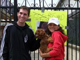Lost Dog named James Brown and his loving owners in front of a sign to help find the missing pet.